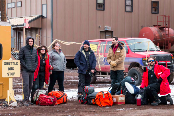 Figure 1: Andy, Britney and the Kamb Team wait for the transport van in explorer pose.