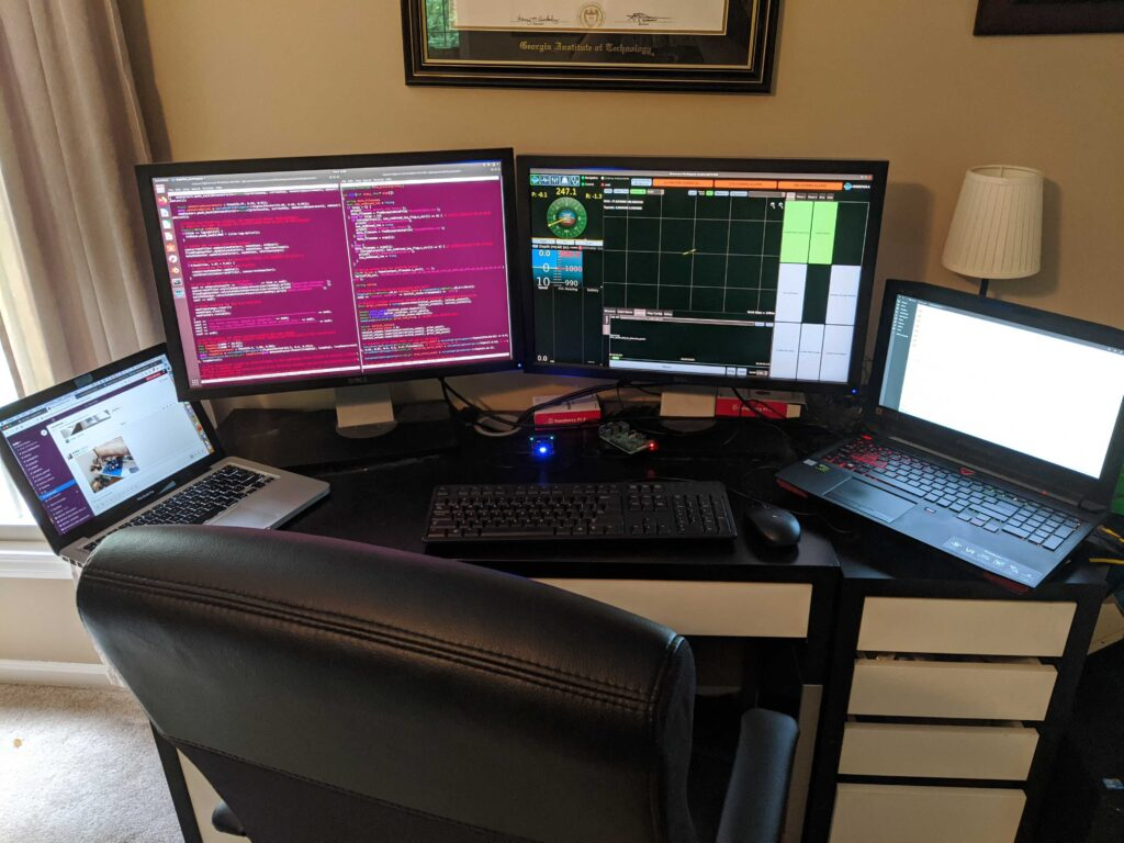 Research Engineer Anthony Spears has no shortage of screens in his home remote-sciencing setup!