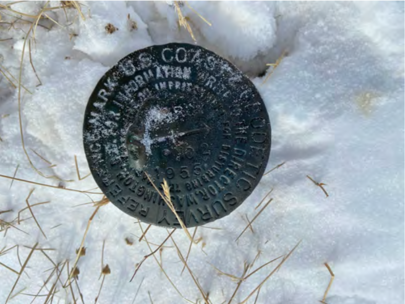 Photo of US geodetic survey marker on top of Percy pingo, the tallest pingo we will survey this season.