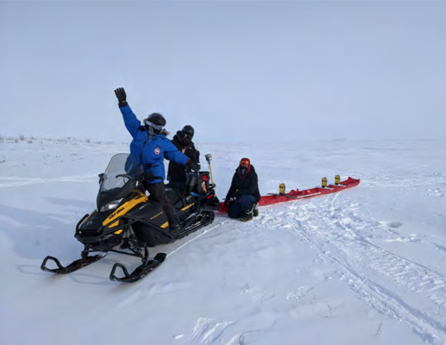 Photo of Members of the survey team showing off the 'super-banana' mode configuration of our tow sled.